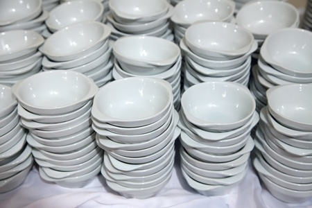 Many  white  bowls stacked together photo
