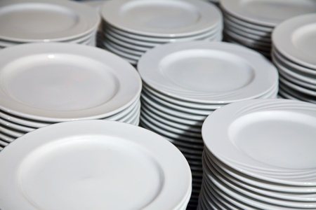 Many  white different plates stacked together photo