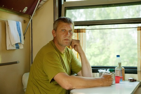 Middle-aged man riding a sleeper train Stock Photo - 12434776