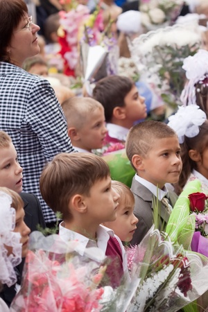 VLADIMIR, RUSSIA - SEPTEMBER 1: Day of Knowledge. First day in school. September 1, 2011 in Vladimir, Russia.Children and parents before secondary school ¹ 36, now school has 1738 pupils Stock Photo - 12272742
