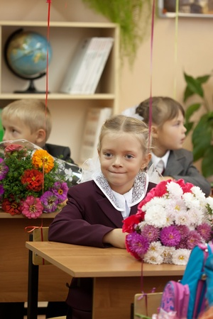 VLADIMIR, RUSSIA - SEPTEMBER 1: Day of Knowledge. First day in school. September 1, 2011 in Vladimir, Russia.Schoolchildren in their first lesson in school ¹ 36, now school has 1738 pupils Stock Photo - 12272739