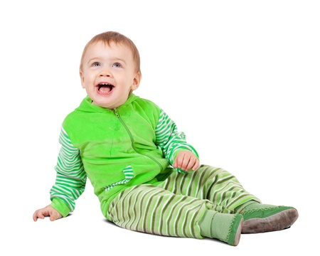 Sitting toddler. Isolated over white background with shadow photo