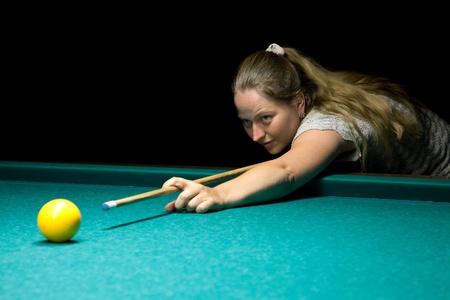 hustler: Casual dressed woman plays russian billiards Stock Photo