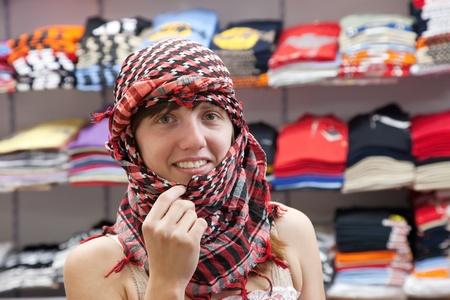 sudarium: woman  in egyptian  shawl at clothes shop