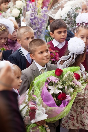 VLADIMIR, RUSSIA - SEPTEMBER 1: Day of Knowledge. First day in school. September 1, 2011 in Vladimir, Russia. Children and parents before secondary school � 36, now school has 1738 pupils Stock Photo - 12287704