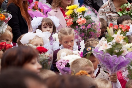 VLADIMIR, RUSSIA - SEPTEMBER 1: Day of Knowledge. First day in school. September 1, 2011 in Vladimir, Russia. Children and parents before secondary school � 36, now school has 1738 pupils Stock Photo - 12287703
