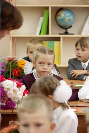 VLADIMIR, RUSSIA - SEPTEMBER 1: Day of Knowledge. First day in school. September 1, 2011 in Vladimir, Russia. Schoolchildren in their first lesson in school � 36, now school has 1738 pupils Stock Photo - 12287700