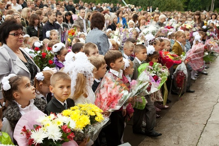 VLADIMIR, RUSSIA - SEPTEMBER 1: Day of Knowledge. First day of school. September 1, 2011 in Vladimir, Russia. Children and parents before secondary school ¹ 36, now school has 1738 pupils Stock Photo - 12287706