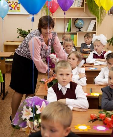VLADIMIR, RUSSIA - SEPTEMBER 1: Day of Knowledge. First day in school. September 1, 2011 in Vladimir, Russia. Schoolchildren in their first lesson in school � 36, now school has 1738 pupils Stock Photo - 12287702