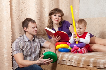 Happy parents with  child in home interior Stock Photo - 12437194