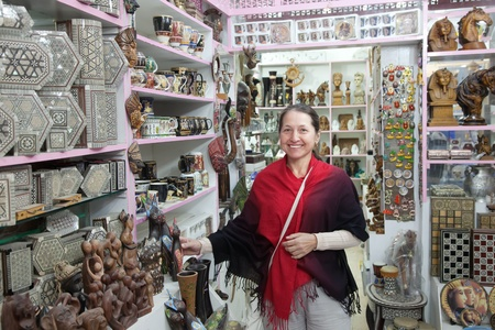 Mature woman  chooses souvenirs in egyptian shop Stock Photo - 12385852