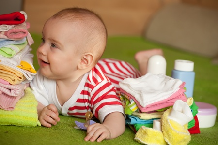 babygro:  baby girl with heap of babys things