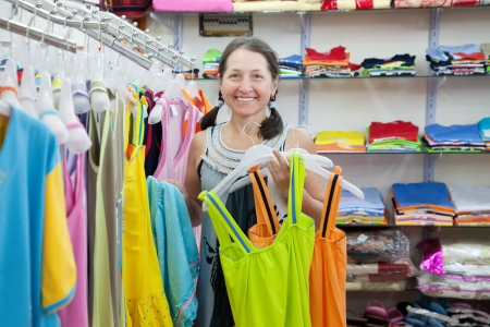 Mature woman  chooses clothes at fashionable shop Stock Photo - 17252131