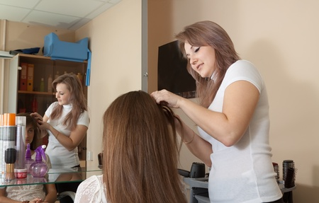 Female hairdresser working with long-haired girl Stock Photo - 12434955