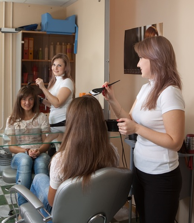 Hairdresser coloring   long-haired girl hair  photo