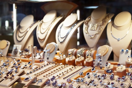 14k: counter with variety of jewelry in store window Editorial
