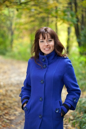 Portrait of brunette woman in autumn park Stock Photo - 12612771