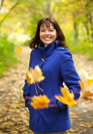Outdoor portrait of happy woman in autumn  Stock Photo - 12612816