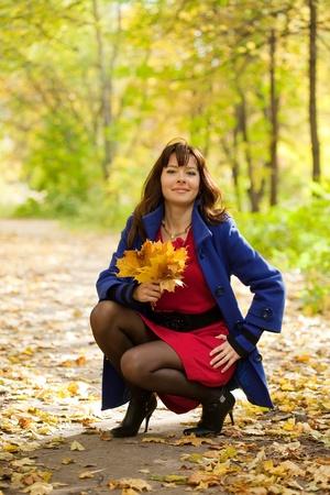 Girl in blue coat at autumn park  photo