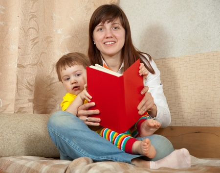 mother and daughter reading book in home Stock Photo - 12602391