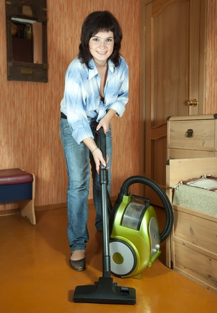Woman cleaning her living room photo
