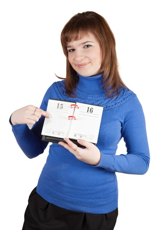 Girl pointing to date in diary  Isoilated over white photo