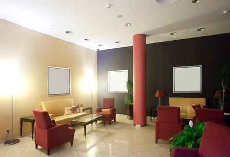 Hall in hotel with red   armchair