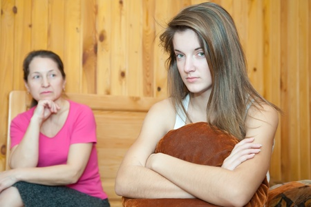 naughty girl: teenager daughter and mother after quarrel at home Stock Photo