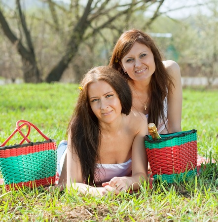 Girlfriends on green grass in the park photo