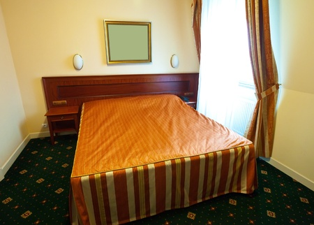 roomservice:  interior of bedroom with double bed Editorial