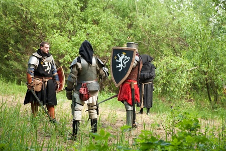Knights in armor before fight at forest photo