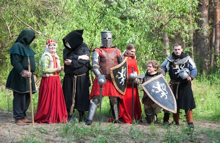 chaplain: People in historical european costumes in forest Stock Photo