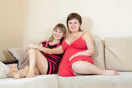 Relaxed women resting on sofa in livingroom at home Stock Photo - 12791073