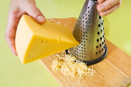 farci: Closeup of cook grating cheese. See in series stages of cooking of farci tomato  salad