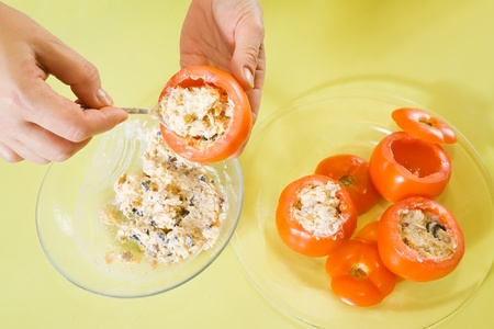 farcie: Closeup of cook stuffing tomato salad. See in series stages of cooking of stuffed tomato salad