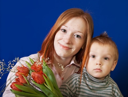 mother with her son over blue background Stock Photo - 12793693
