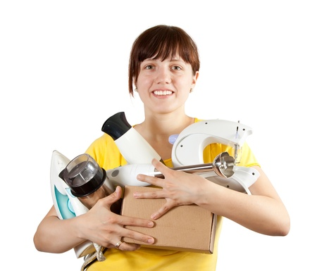 Girl with household appliances over white photo