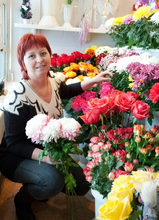 Female florist in her small  flower shop photo