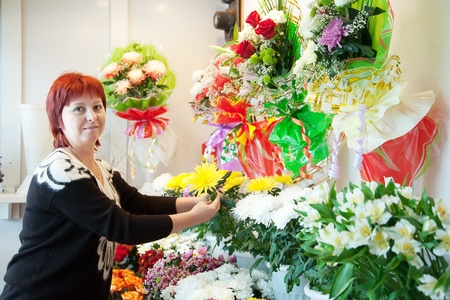 Middle-aged woman in  flower shop photo
