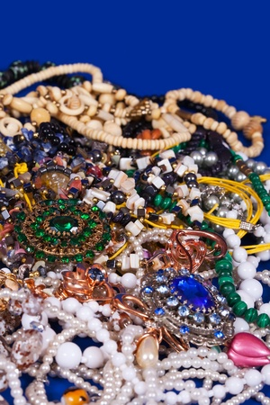Close up of many differently jewellery background  photo