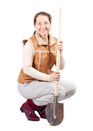 habitual: Happy pastoral  woman sits with spade over white