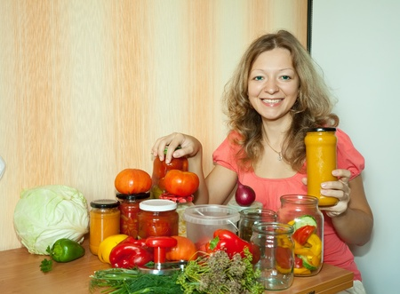 Woman with marinated vegetables in the kitchen photo