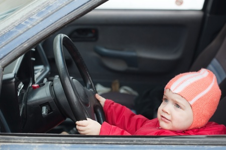 Little baby girl driving  car vehicle photo