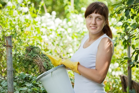 Female farmer making compost in garden Stock Photo - 12791254