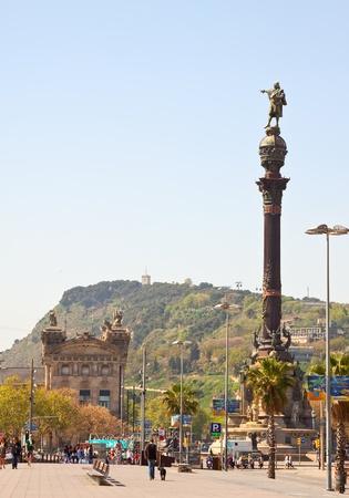 ramblas: BARCELONA, SPAIN - APRIL 12: Tourists walking near Columbus monument in April 12, 2011 in Barcelona, Spain.  Columbus Monument is 60 m. It is located at finish La Rambla and built in 1888 Editorial