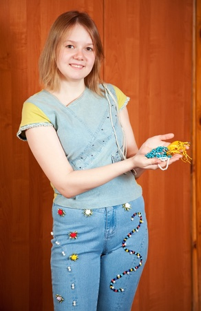 stitchwork: girl shows a handmade cloth beaded by herself Stock Photo