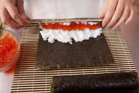 Close up of cook making  Japanese sushi rolls photo