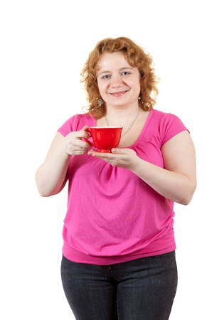 ordinary woman: Overweight woman with tea cup. Isolated over white background