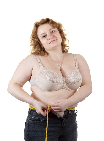 fat woman measuring waist. Isolated over white background photo