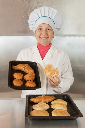 Baker with fresh pastries at bakery Stock Photo - 13024303